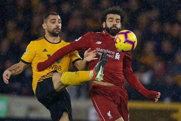 WOLVERHAMPTON, ENGLAND - Friday, December 21, 2018: Liverpool's Mohamed Salah is challenged by Wolverhampton Wanderers' Jonny Castro (L) during the FA Premier League match between Wolverhampton Wanderers FC and Liverpool FC at Molineux Stadium. (Pic by David Rawcliffe/Propaganda)