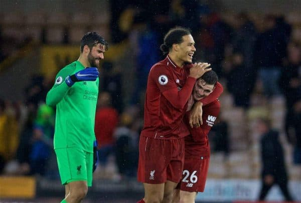 WOLVERHAMPTON, ENGLAND - Friday, December 21, 2018: Liverpool's goal-scorer Virgil van Dijk celebrates with team-mates Andy Robertson (R) and goalkeeper Alisson Becker (L) after beating Wolverhampton Wanderers 2-0 during the FA Premier League match between Wolverhampton Wanderers FC and Liverpool FC at Molineux Stadium. (Pic by David Rawcliffe/Propaganda)