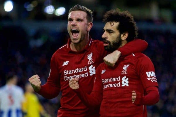 BRIGHTON AND HOVE, ENGLAND - Saturday, January 12, 2019: Liverpool's Mohamed Salah celebrates scoring the winning goal from a penalty kick with team-mate captain Jordan Henderson (L) during the FA Premier League match between Brighton & Hove Albion FC and Liverpool FC at the American Express Community Stadium. Liverpool won 1-0. (Pic by David Rawcliffe/Propaganda)