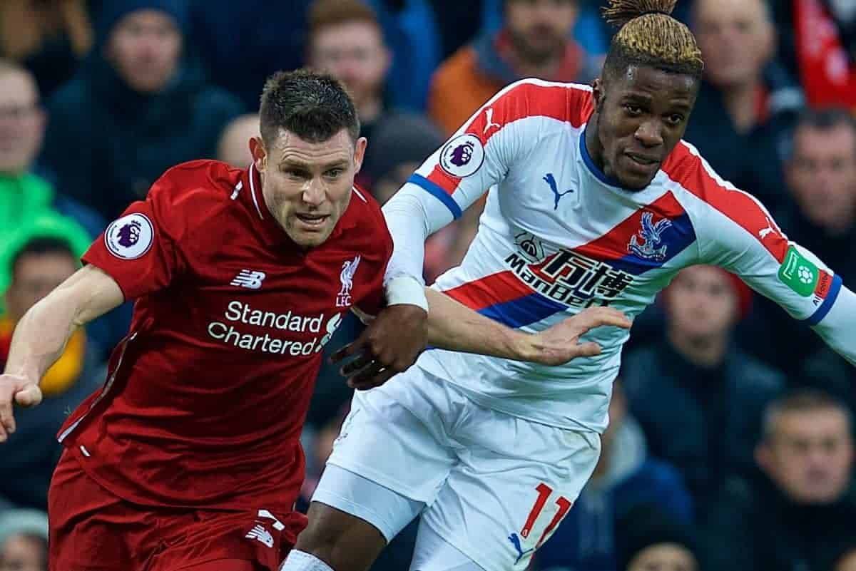 LIVERPOOL, ENGLAND - Saturday, January 19, 2019: Liverpool's James Milner (L) and Crystal Palace's Wilfried Zaha during the FA Premier League match between Liverpool FC and Crystal Palace FC at Anfield. (Pic by David Rawcliffe/Propaganda)