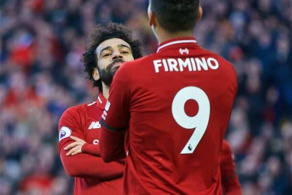 LIVERPOOL, ENGLAND - Saturday, February 9, 2019: Liverpool's Mohamed Salah celebrates scoring the third goal with team-mate Roberto Firmino during the FA Premier League match between Liverpool FC and AFC Bournemouth at Anfield. (Pic by David Rawcliffe/Propaganda)