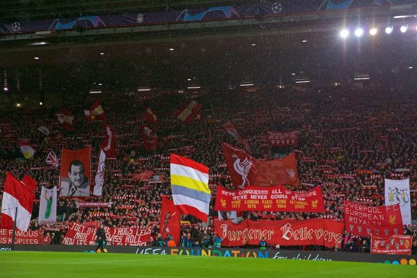 "LIVERPOOL, ENGLAND - Tuesday, February 19, 2019: Liverpool supporters on the Spion Kop sing ""You'll Never Walk Alone"" before the UEFA Champions League Round of 16 1st Leg match between Liverpool FC and FC Bayern München at Anfield. (Pic by David Rawcliffe/Propaganda)"