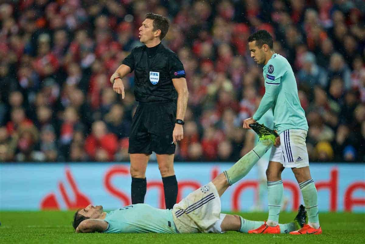 LIVERPOOL, ENGLAND - Tuesday, February 19, 2019: FC Bayern Munich's Javi Martínez lies injured as referee Gianluca Rocchi looks on during the UEFA Champions League Round of 16 1st Leg match between Liverpool FC and FC Bayern München at Anfield. (Pic by David Rawcliffe/Propaganda)