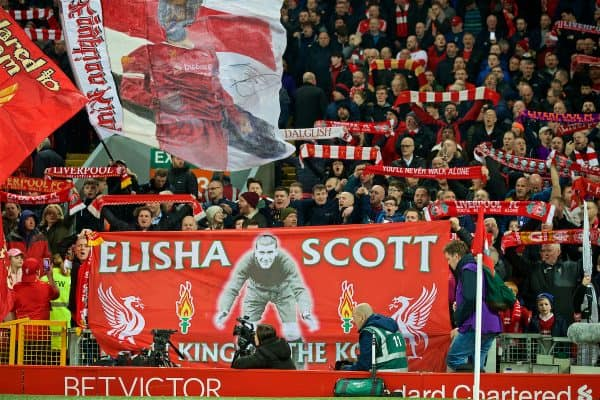 LIVERPOOL, ENGLAND - Wednesday, February 27, 2019: Liverpool supporters on the Spion Kop with a banner featuring former goalkeeper Elisha Scott before the FA Premier League match between Liverpool FC and Watford FC at Anfield. (Pic by Paul Greenwood/Propaganda)