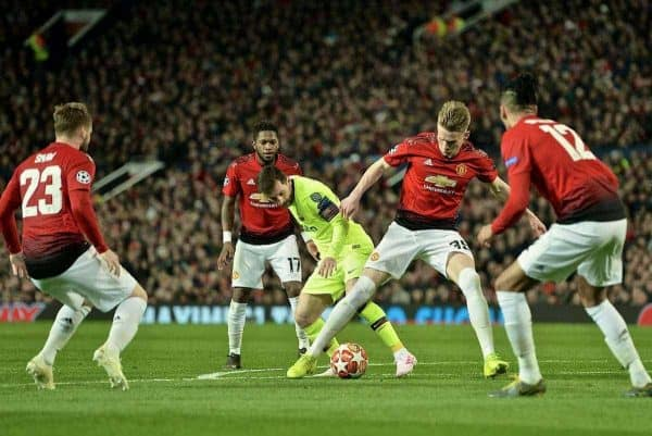 MANCHESTER, ENGLAND - Thursday, April 11, 2019: Barcelona's captain Lionel Messi is tackled by Manchester United's Scott McTominay during the UEFA Champions League Quarter-Final 1st Leg match between Manchester United FC and FC Barcelona at Old Trafford. Barcelona won 1-0. (Pic by David Rawcliffe/Propaganda)