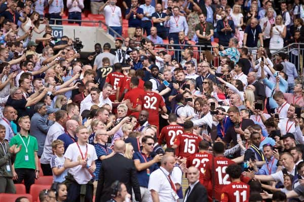 LONDON, ENGLAND - Sunday, August 4, 2019: Liverpool players climb the steps to pick up their runners-up medals after the penalty shoot out to decide the FA Community Shield match between Manchester City FC and Liverpool FC at Wembley Stadium. Manchester City won 5-4 on penalties after a 1-1 draw. (Pic by David Rawcliffe/Propaganda)