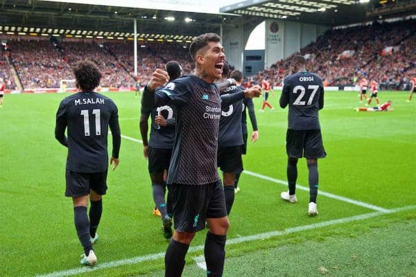Liverpool's Roberto Firmino celebrates after his team-mate Georginio Wijnaldum (not shown) scored the only goal of the game during the FA Premier League match between Sheffield United FC and Liverpool FC at Bramall Lane. Liverpool won 1-0. (Pic by David Rawcliffe/Propaganda)