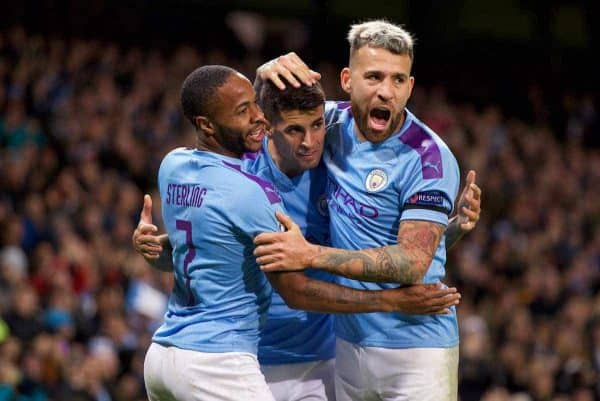 MANCHESTER, ENGLAND - Tuesday, October 1, 2019: Manchester City's Raheem Sterling (L) celebrates scoring the first goal with team-mates João Cancelo (C) and Nicolás Otamendi (R) during the UEFA Champions League Group C match between Manchester City FC and GNK Dinamo Zagreb at the City of Manchester Stadium. (Pic by David Rawcliffe/Propaganda)