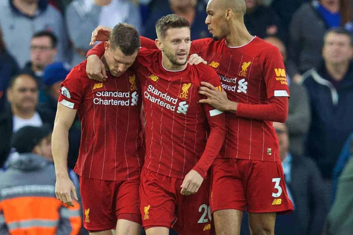 Liverpool's James Milner (L) celebrates with team-mates Adam Lallana (C) and Fabio Henrique Tavares 'Fabinho' (R) after scoring the winning second goal, an injury time penalty, during the FA Premier League match between Liverpool FC and Leicester City FC at Anfield. Liverpool won 2-1. (Pic by David Rawcliffe/Propaganda)