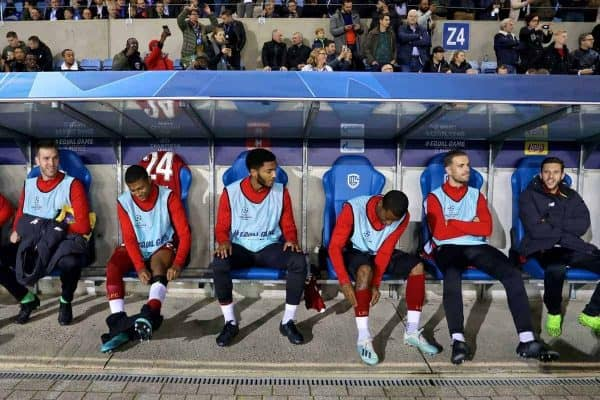 GENK, BELGIUM - Wednesday, October 23, 2019: Liverpool's substitutes (L-R) Divock Origi, goalkeeper Adrián San Miguel del Castillo, Rhian Brewster, Joe Gomez, Georginio Wijnaldum, captain Jordan Henderson and Adam Lallana on the bench before the UEFA Champions League Group E match between KRC Genk and Liverpool FC at the KRC Genk Arena. (Pic by David Rawcliffe/Propaganda)