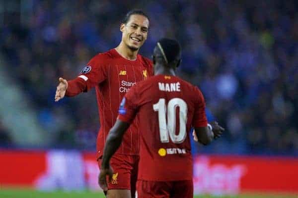 GENK, BELGIUM - Wednesday, October 23, 2019: Liverpool's Sadio Mané (R) celebrates scoring the third goal with team-mate Virgil van Dijk during the UEFA Champions League Group E match between KRC Genk and Liverpool FC at the KRC Genk Arena. (Pic by David Rawcliffe/Propaganda)
