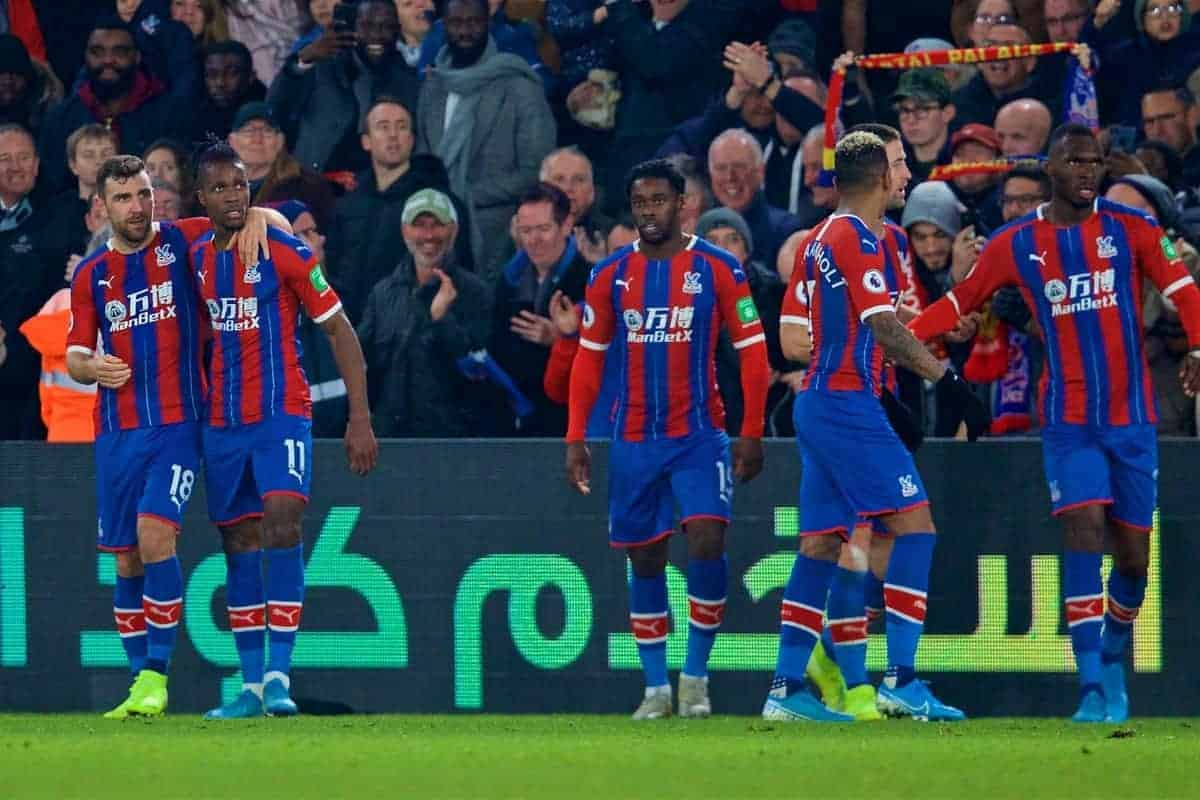 Crystal Palace's Wilfried Zaha (2nd from L) celebrates scoring the first goal with team-mates during the FA Premier League match between Crystal Palace and Liverpool FC at Selhurst Park. (Pic by David Rawcliffe/Propaganda)
