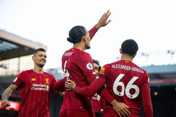 Liverpool's Virgil van Dijk (C) celebrates scoring the second goal, his second of the game, during the FA Premier League match between Liverpool FC and Brighton & Hove Albion FC at Anfield. Liverpool won 2-1. (Pic by David Rawcliffe/Propaganda)