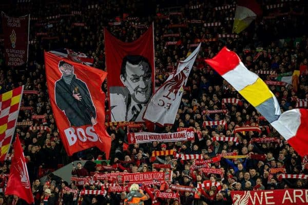 LIVERPOOL, ENGLAND - Wednesday, December 4, 2019: Liverpool supporters on the Spion Kop with flags featuring manager Jürgen Klopp and former manger Bob Paisley before the FA Premier League match between Liverpool FC and Everton FC, the 234th Merseyside Derby, at Anfield. (Pic by David Rawcliffe/Propaganda)