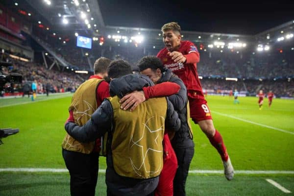 SALZBURG, AUSTRIA - Tuesday, December 10, 2019: Liverpool's Mohamed Salah (hidden) celebrates scoring the second goal with team-mates as Roberto Firmino jumps ontop during the final UEFA Champions League Group E match between FC Salzburg and Liverpool FC at the Red Bull Arena. (Pic by David Rawcliffe/Propaganda)