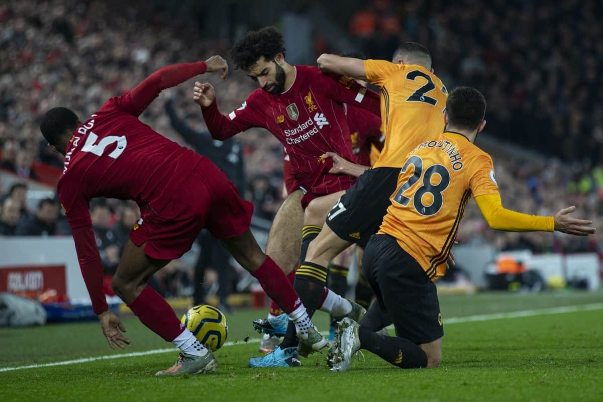 LIVERPOOL, ENGLAND - Sunday, December 29, 2019: Wolverhampton Wanderers' Romain Saïss and João Moutinho tackle Liverpool's Georginio Wijnaldum and Mohamed Salah during the FA Premier League match between Liverpool FC and Wolverhampton Wanderers FC at Anfield. (Pic by David Rawcliffe/Propaganda)
