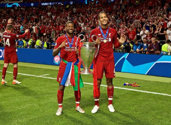 MADRID, SPAIN - SATURDAY, JUNE 1, 2019: Liverpool's Georginio Wijnaldum (L) and Virgil van Dijk (R) with the trophy after the UEFA Champions League Final match between Tottenham Hotspur FC and Liverpool FC at the Estadio Metropolitano. Liverpool won 2-0 to win their sixth European Cup. (Pic by David Rawcliffe/Propaganda)