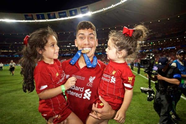 MADRID, SPAIN - SATURDAY, JUNE 1, 2019: Liverpool's Roberto Firmino bites his medal with his children after the UEFA Champions League Final match between Tottenham Hotspur FC and Liverpool FC at the Estadio Metropolitano. Liverpool won 2-0 to win their sixth European Cup. (Pic by David Rawcliffe/Propaganda)
