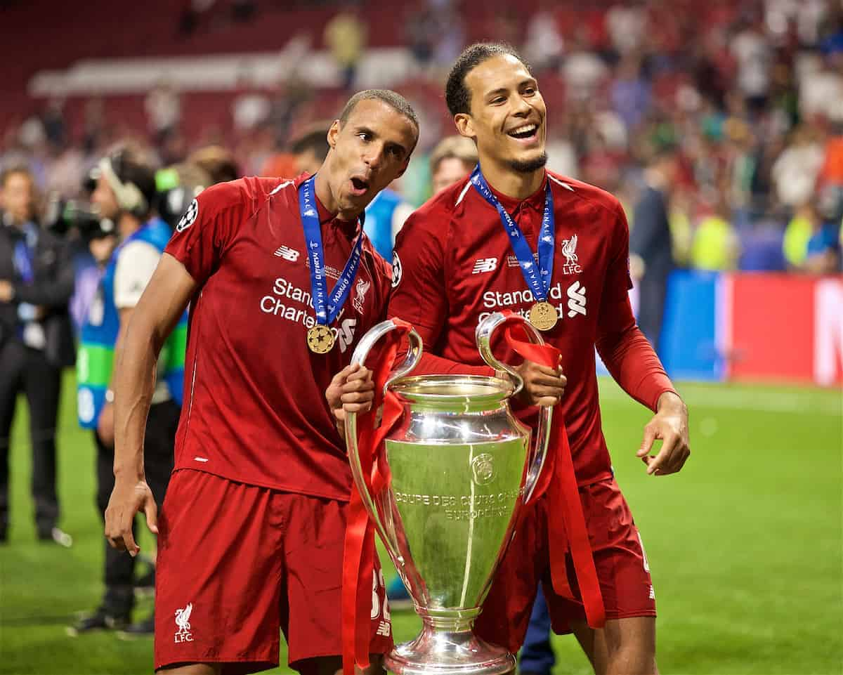 MADRID, SPAIN - SATURDAY, JUNE 1, 2019: Liverpool's Joel Matip (L) and Virgil van Dijk (R) after the UEFA Champions League Final match between Tottenham Hotspur FC and Liverpool FC at the Estadio Metropolitano. Liverpool won 2-0 to win their sixth European Cup. (Pic by David Rawcliffe/Propaganda)