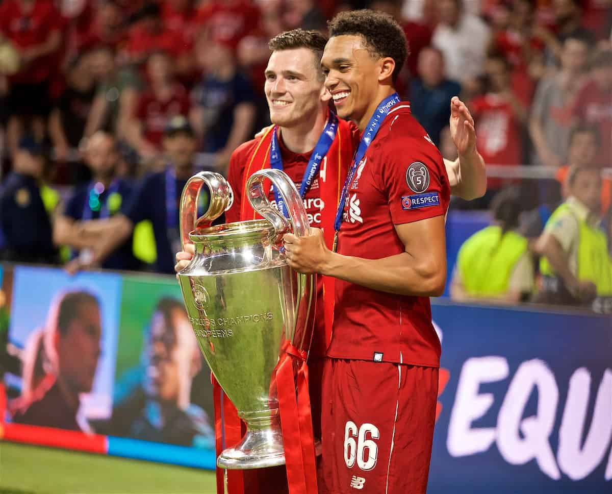 MADRID, SPAIN - SATURDAY, JUNE 1, 2019: Liverpool's Andy Robertson (L) and Trent Alexander-Arnold with the trophy after the UEFA Champions League Final match between Tottenham Hotspur FC and Liverpool FC at the Estadio Metropolitano. Liverpool won 2-0 to win their sixth European Cup. (Pic by David Rawcliffe/Propaganda)