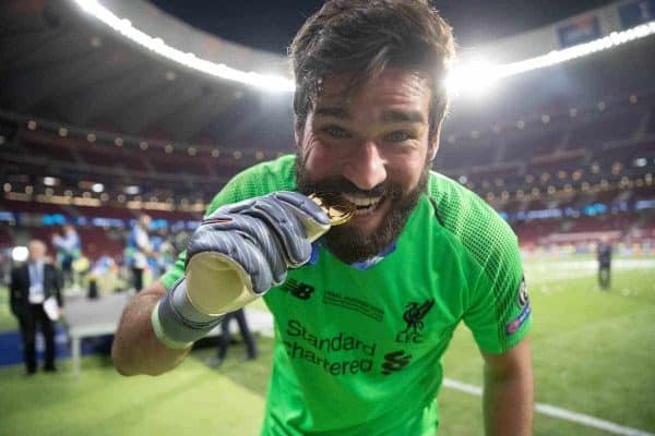 MADRID, SPAIN - SATURDAY, JUNE 1, 2019: Liverpool's goalkeeper Alisson Becker celebrates by biting his medal after the UEFA Champions League Final match between Tottenham Hotspur FC and Liverpool FC at the Estadio Metropolitano. Liverpool won 2-0 to win their sixth European Cup. (Pic by Peter Makadi/Propaganda)