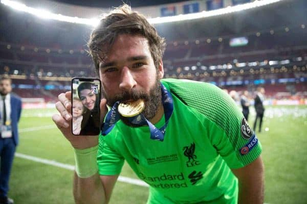 MADRID, SPAIN - SATURDAY, JUNE 1, 2019: Liverpool's goalkeeper Alisson Becker celebrates by biting his medal and FaceTiming his wife and family after the UEFA Champions League Final match between Tottenham Hotspur FC and Liverpool FC at the Estadio Metropolitano. Liverpool won 2-0 to win their sixth European Cup. (Pic by Peter Makadi/Propaganda)