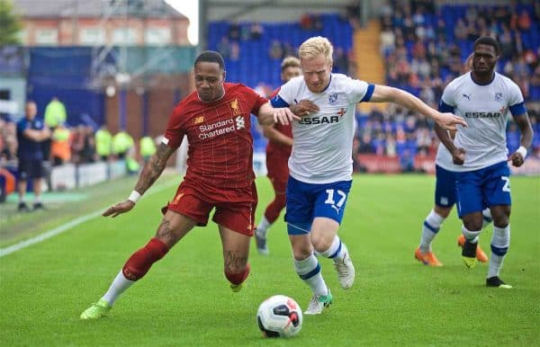 BIRKENHEAD, ENGLAND - Thursday, July 11, 2019: Liverpool's Nathaniel Clyne (L) and Tranmere Rovers' David Perkins during a pre-season friendly match between Tranmere Rovers FC and Liverpool FC at Prenton Park. (Pic by David Rawcliffe/Propaganda)