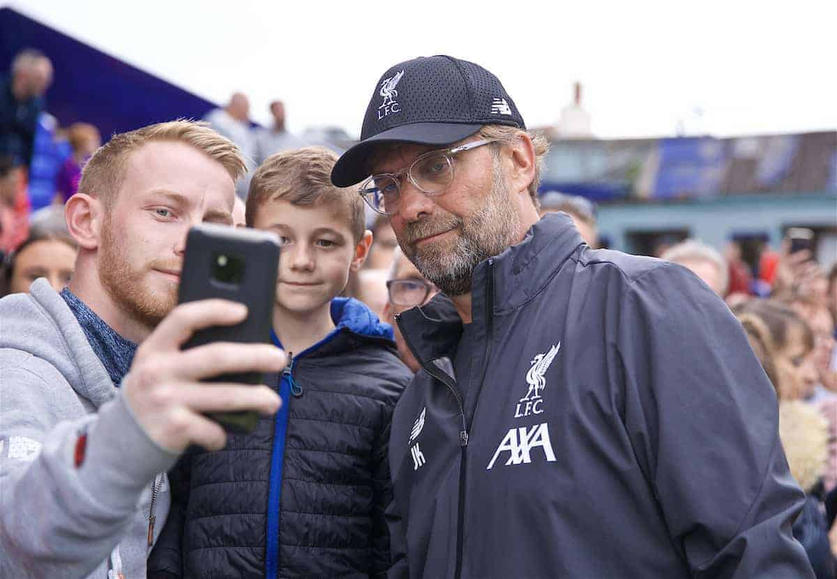 BIRKENHEAD, ENGLAND - Thursday, July 11, 2019: Liverpool's manager Jürgen Klopp poses for a selfie with a supporter before a pre-season friendly match between Tranmere Rovers FC and Liverpool FC at Prenton Park. (Pic by David Rawcliffe/Propaganda)