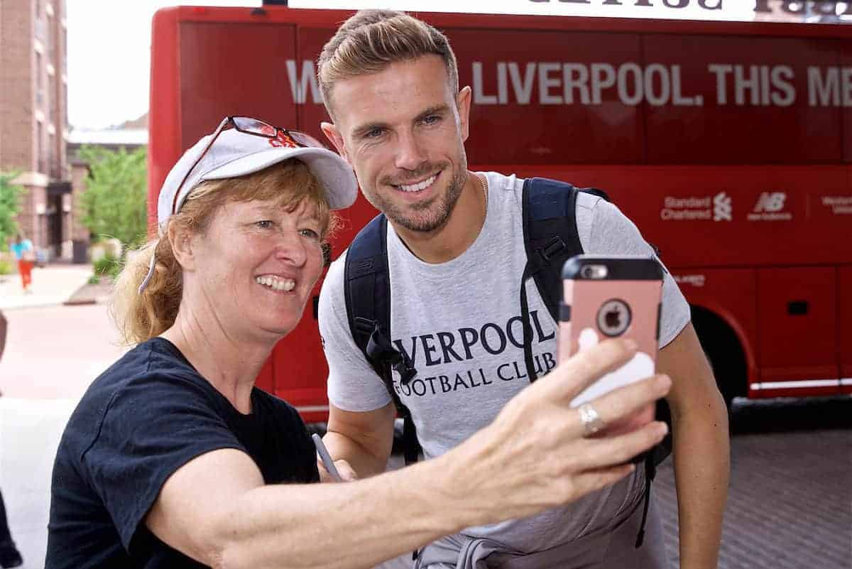 SOUTH BEND, INDIANA, USA - Tuesday, July 16, 2019: Liverpool's captain Jordan Henderson poses for a photograph with a supporter as the squad arrives at the team hotel in South Bend at the start of the club's pre-season tour of America. (Pic by David Rawcliffe/Propaganda)