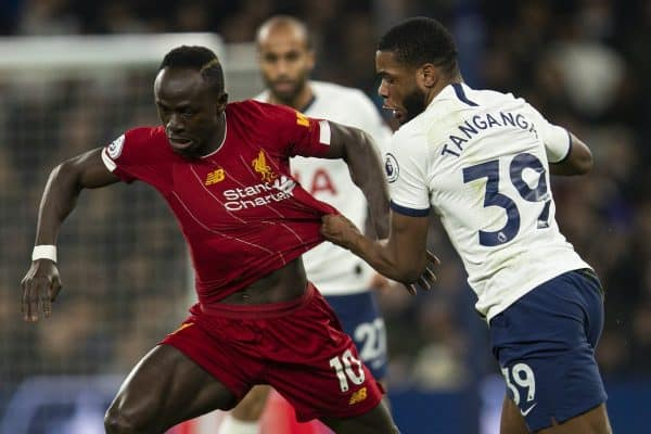 LONDON, ENGLAND - Saturday, January 11, 2020: Liverpool's Sadio Mané (L) is pulled back by Tottenham Hotspur's Japhet Tanganga during the FA Premier League match between Tottenham Hotspur FC and Liverpool FC at the Tottenham Hotspur Stadium. (Pic by David Rawcliffe/Propaganda)