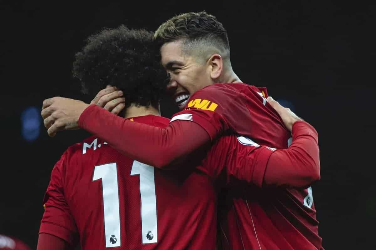 Liverpool's Roberto Firmino celebrates after scoring the winning goal with team-mate Mohamed Salah (L) during the FA Premier League match between Tottenham Hotspur FC and Liverpool FC at the Tottenham Hotspur Stadium. Liverpool won 1-0. (Pic by David Rawcliffe/Propaganda)