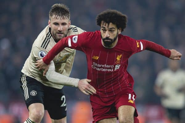 LIVERPOOL, ENGLAND - Sunday, January 19, 2020: Liverpool's Mohamed Salah (R) and Manchester United's Luke Shaw during the FA Premier League match between Liverpool FC and Manchester United FC at Anfield. (Pic by David Rawcliffe/Propaganda)