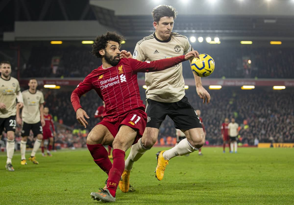 LIVERPOOL, ENGLAND - Sunday, January 19, 2020: Liverpool's Mohamed Salah (L) and Manchester United's captain Harry Maguire during the FA Premier League match between Liverpool FC and Manchester United FC at Anfield. (Pic by David Rawcliffe/Propaganda)