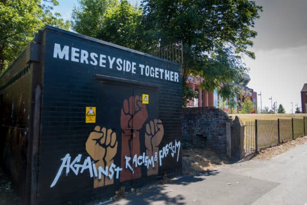 """LIVERPOOL, ENGLAND - Monday, June 1, 2020: """"Merseyside Together Against Racism and Fascism"""" Graffiti painted on a wall in Stanley Park, Anfield, between Liverpool FC's and Everton FC's stadiums. The mural appeared in response to the growing global unrest and protest at the murder of George Floyd by a white police officer in Minneapolis, USA. (Pic by David Rawcliffe/Propaganda)"""