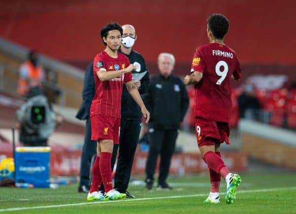 Liverpool's substitute Takumi Minamino prepares to replace Roberto Firmino during the FA Premier League match between Liverpool FC and Crystal Palace FC at Anfield. The game was played behind closed doors due to the UK government's social distancing laws during the Coronavirus COVID-19 Pandemic. (Pic by David Rawcliffe/Propaganda)