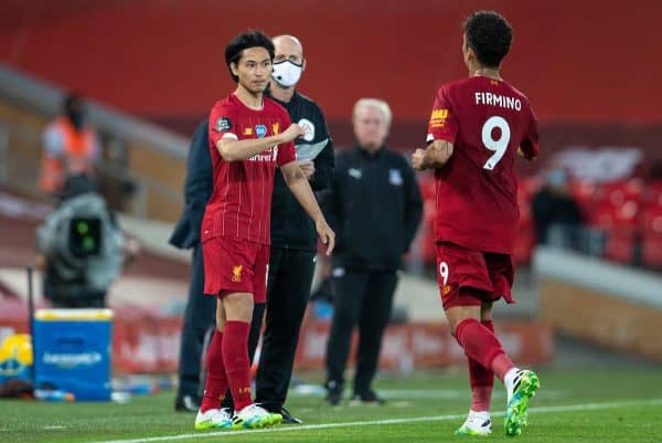 LIVERPOOL, ENGLAND - Wednesday, June 24, 2020: Liverpool's substitute Takumi Minamino prepares to replace Roberto Firmino during the FA Premier League match between Liverpool FC and Crystal Palace FC at Anfield. The game was played behind closed doors due to the UK government's social distancing laws during the Coronavirus COVID-19 Pandemic. (Pic by David Rawcliffe/Propaganda)