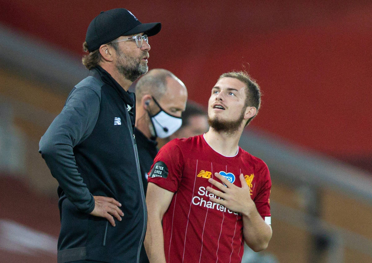 LIVERPOOL, ENGLAND - Wednesday, June 24, 2020: Liverpool's Harvey Elliott looks up towards the tall presence of manager Jürgen Klopp as he prepares to come on as a substitute during the FA Premier League match between Liverpool FC and Crystal Palace FC at Anfield. The game was played behind closed doors due to the UK government's social distancing laws during the Coronavirus COVID-19 Pandemic. (Pic by David Rawcliffe/Propaganda)