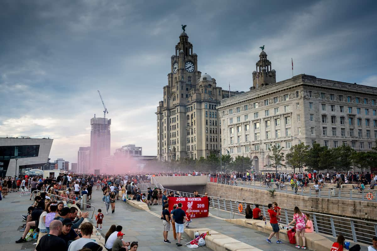 LIVERPOOL, ENGLAND - Friday, June 26, 2020: Liverpool supporters celebrate their team's Premier League title victory at the Pier Head, Liverpool. With government COVID-19 restrictions in place the games have been played behind closed doors without fans. Liverpool won their 19th top-flight Championshop with seven games of the seaosn left, a record, it was the club's first title in 30 years and the first of the FA Premier League era. (Pic by David Rawcliffe/Propaganda)