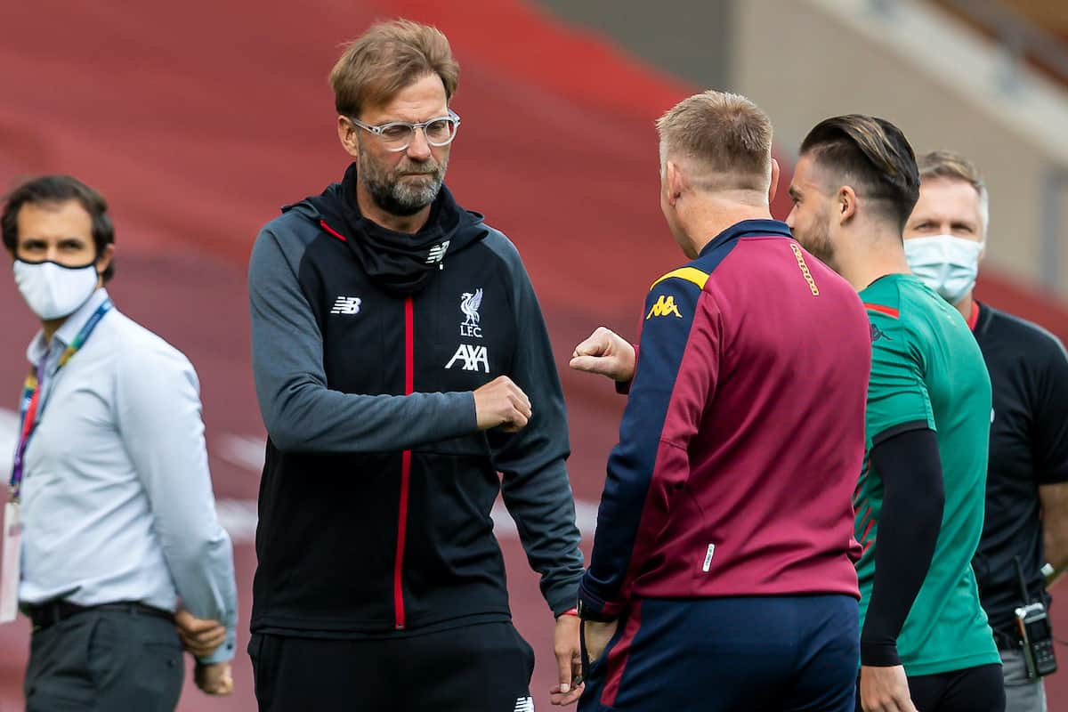 LIVERPOOL, ENGLAND - Sunday, July 5, 2020: Liverpool's manager Jürgen Klopp (L) and Aston Villa's manager Dean Smith greet each other before the FA Premier League match between Liverpool FC and Aston Villa FC at Anfield. The game was played behind closed doors due to the UK government's social distancing laws during the Coronavirus COVID-19 Pandemic. (Pic by David Rawcliffe/Propaganda)