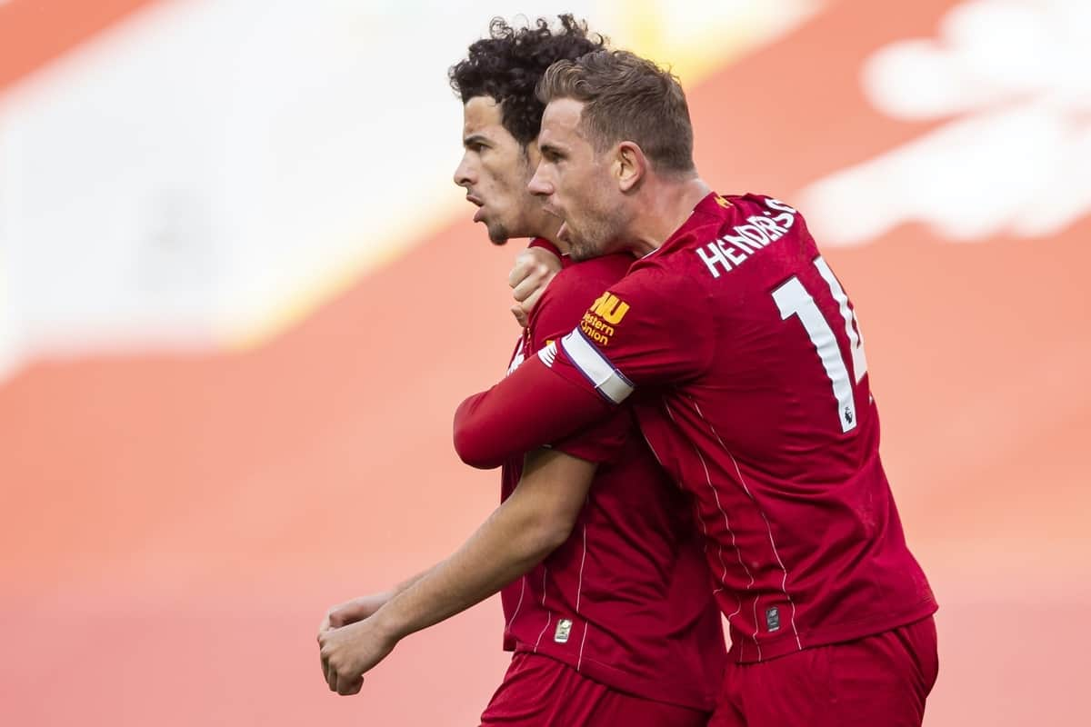 LIVERPOOL, ENGLAND - Sunday, July 5, 2020: Liverpool's Curtis Jones celebrates scoring the second goal with team-mate captain Jordan Henderson (R) during the FA Premier League match between Liverpool FC and Aston Villa FC at Anfield. The game was played behind closed doors due to the UK government's social distancing laws during the Coronavirus COVID-19 Pandemic. (Pic by David Rawcliffe/Propaganda)