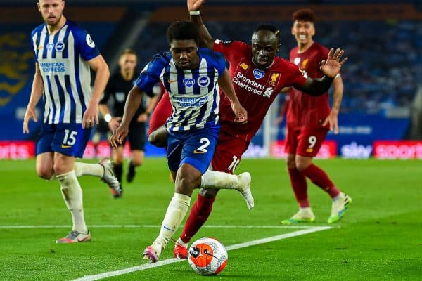BRIGHTON & HOVE, ENGLAND - Wednesday, July 8, 2020: Liverpool's Sadio Mané and Brighton & Hove Albion's Tariq Lamptey during the FA Premier League match between Brighton & Hove Albion FC and Liverpool FC at the AMEX Stadium. The game was played behind closed doors due to the UK government's social distancing laws during the Coronavirus COVID-19 Pandemic. (Pic by Propaganda)