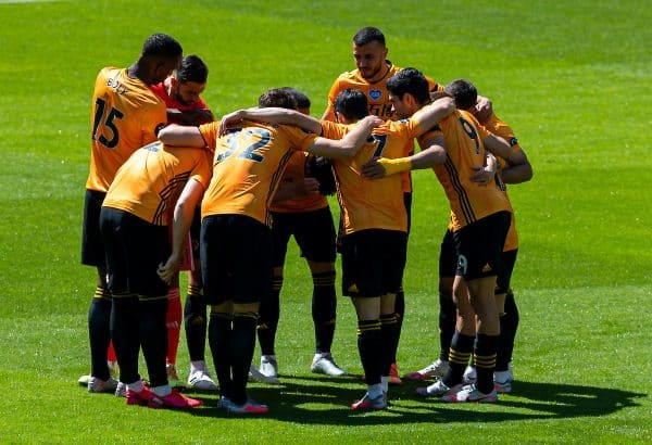 WOLVERHAMPTON, ENGLAND - Sunday, July 12, 2020: Wolverhampton Wanderers form a pre-match huddle before the FA Premier League match between Wolverhampton Wanderers FC and Everton FC at Molineux Stadium. The game was played behind closed doors due to the UK government's social distancing laws during the Coronavirus COVID-19 Pandemic. (Pic by David Rawcliffe/Propaganda)