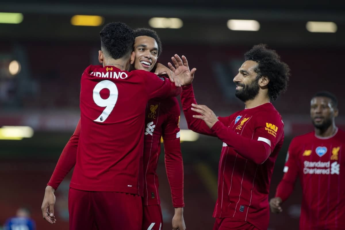 LIVERPOOL, ENGLAND - Wednesday, July 22, 2020: Liverpool's Roberto Firmino (#9) celebrates scoring the fourth goal, to make the score 4-1, with team-mates Trent Alexander-Arnold (C) and Mohamed Salah (R) during the FA Premier League match between Liverpool FC and Chelsea FC at Anfield. The game was played behind closed doors due to the UK government's social distancing laws during the Coronavirus COVID-19 Pandemic. (Pic by David Rawcliffe/Propaganda)