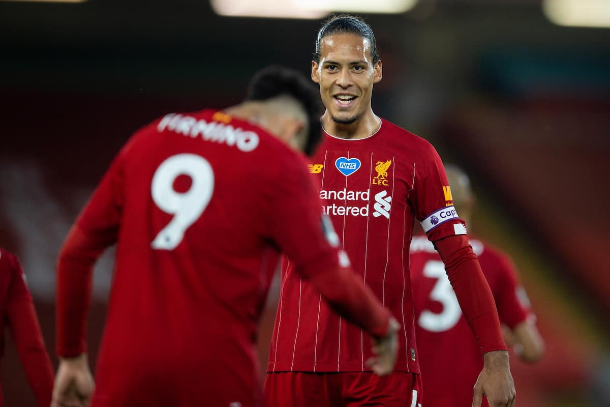 LIVERPOOL, ENGLAND - Wednesday, July 22, 2020: Liverpool's Virgil van Dijk celebrates with goal-scorer Roberto Firmino after the fourth goal during the FA Premier League match between Liverpool FC and Chelsea FC at Anfield. The game was played behind closed doors due to the UK government's social distancing laws during the Coronavirus COVID-19 Pandemic. (Pic by David Rawcliffe/Propaganda)