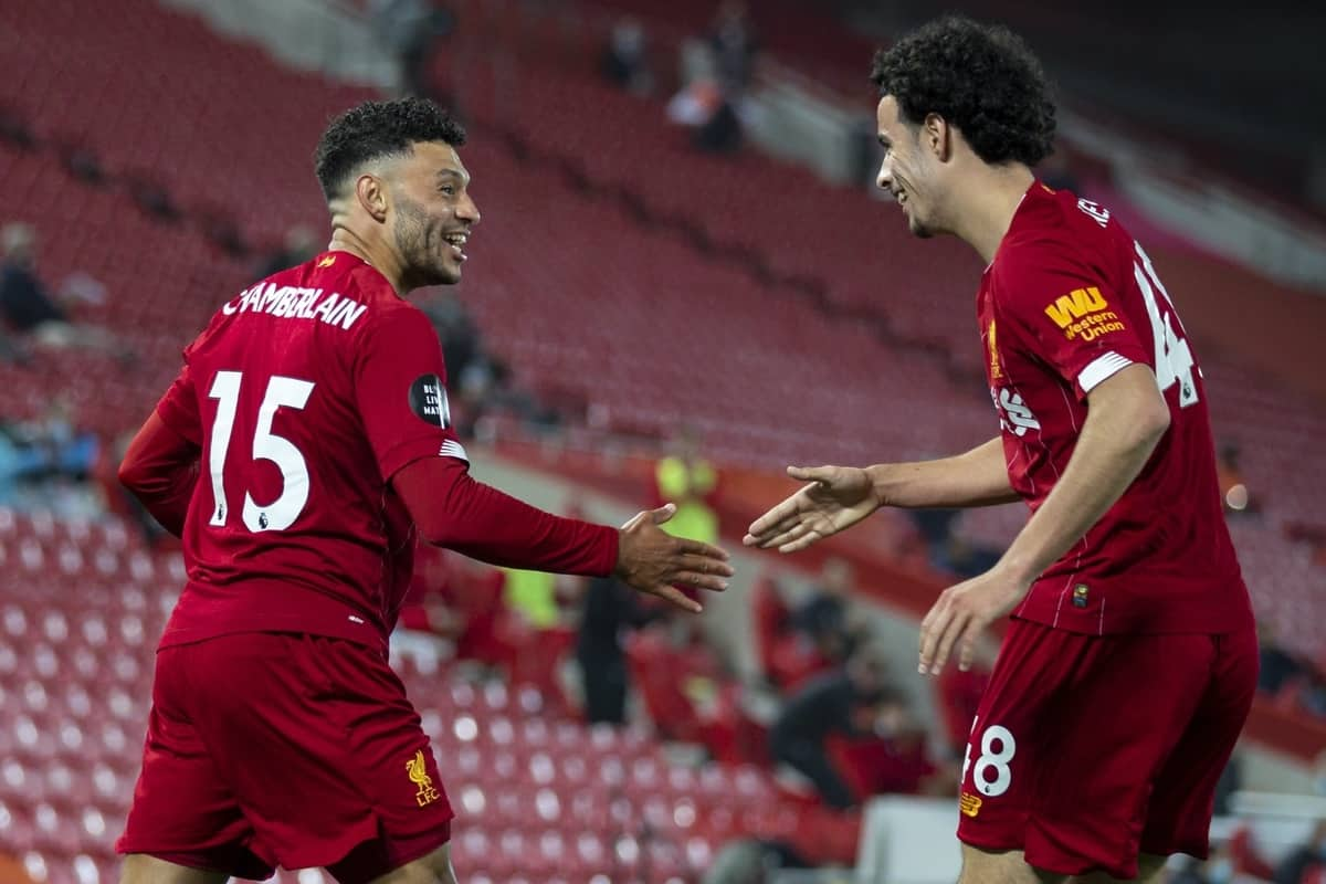 LIVERPOOL, ENGLAND - Wednesday, July 22, 2020: Liverpool's Alex Oxlade-Chamberlain (C) celebrates scoring his side's fifth goal, to make the score 5-3, with team-mate Curtis Jones during the FA Premier League match between Liverpool FC and Chelsea FC at Anfield. The game was played behind closed doors due to the UK government's social distancing laws during the Coronavirus COVID-19 Pandemic. (Pic by David Rawcliffe/Propaganda)