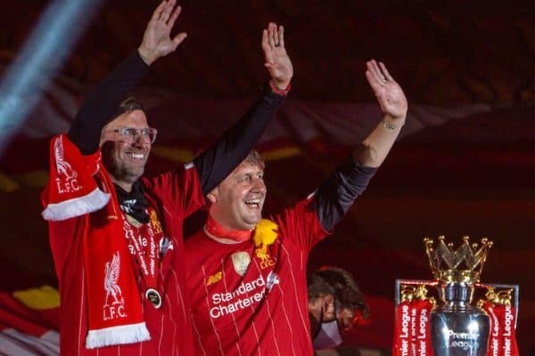 Liverpool's manager Jürgen Klopp (L) and assistant manager Peter Krawietz celebrate on the podium during the trophy presentation as the Reds are crowned Champions after the FA Premier League match between Liverpool FC and Chelsea FC at Anfield. The game was played behind closed doors due to the UK government's social distancing laws during the Coronavirus COVID-19 Pandemic. (Pic by David Rawcliffe/Propaganda)