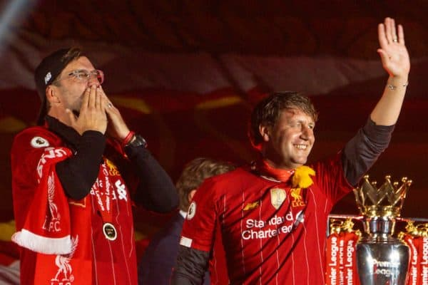 LIVERPOOL, ENGLAND - Wednesday, July 22, 2020: Liverpool's manager Jürgen Klopp (L) and assistant manager Peter Krawietz celebrate on the podium during the trophy presentation as the Reds are crowned Champions after the FA Premier League match between Liverpool FC and Chelsea FC at Anfield. The game was played behind closed doors due to the UK government's social distancing laws during the Coronavirus COVID-19 Pandemic. (Pic by David Rawcliffe/Propaganda)