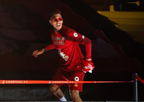 LIVERPOOL, ENGLAND - Wednesday, July 22, 2020: Liverpool's Roberto Firmino celebrates on the podium during the trophy presentation as the Reds are crowned Champions after the FA Premier League match between Liverpool FC and Chelsea FC at Anfield. The game was played behind closed doors due to the UK government's social distancing laws during the Coronavirus COVID-19 Pandemic. (Pic by David Rawcliffe/Propaganda)