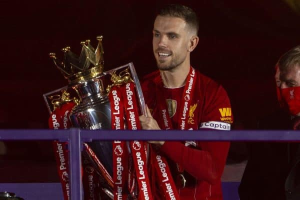 LIVERPOOL, ENGLAND - Wednesday, July 22, 2020: Liverpool's captain Jordan Henderson collects the Premier League trophy during the trophy presentation as the Reds are crowned Champions after the FA Premier League match between Liverpool FC and Chelsea FC at Anfield. The game was played behind closed doors due to the UK government's social distancing laws during the Coronavirus COVID-19 Pandemic. (Pic by David Rawcliffe/Propaganda)