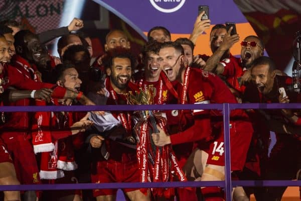 LIVERPOOL, ENGLAND - Wednesday, July 22, 2020: Liverpool's captain Jordan Henderson performs his traditional shuffle before lifting the Premier League trophy during the trophy presentation as the Reds are crowned Champions after the FA Premier League match between Liverpool FC and Chelsea FC at Anfield. The game was played behind closed doors due to the UK government's social distancing laws during the Coronavirus COVID-19 Pandemic. (Pic by David Rawcliffe/Propaganda)